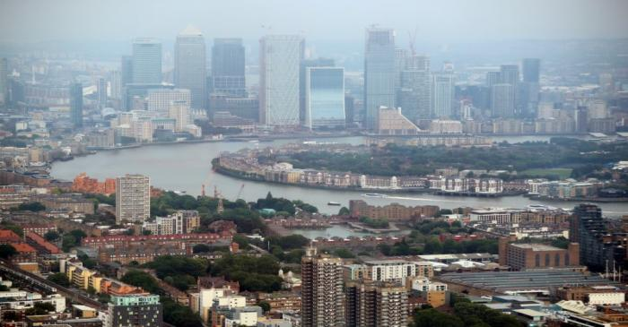 FILE PHOTO: The Canary Wharf financial district is seen from the construction site of 22