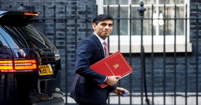 Britain's Chancellor of the Exchequer Rishi Sunak walks at Downing Street in London