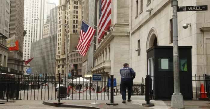 A trader arrives at the NYSE on Wall St. in New York