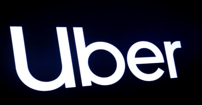 FILE PHOTO: A screen displays the company logo for Uber Technologies Inc. on the day of it's