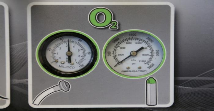 FILE PHOTO: Gauges to regulate oxygen on a ventilator are seen at a lab run by the University