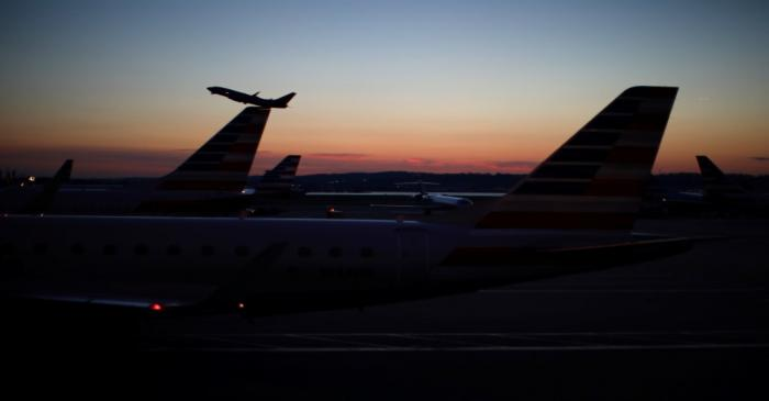 An airplane takes off from the Ronald Reagan National Airport as air traffic is affected by the