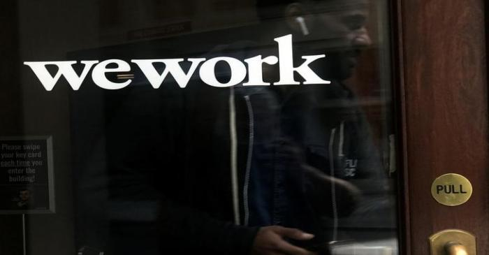 A man walks out of a WeWork space in the Manhattan borough of New York City