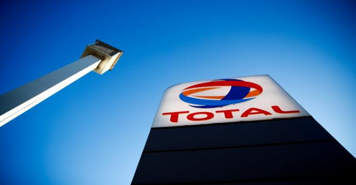 FILE PHOTO: The logo of French oil and gas company Total is seen in a petrol station in Paris