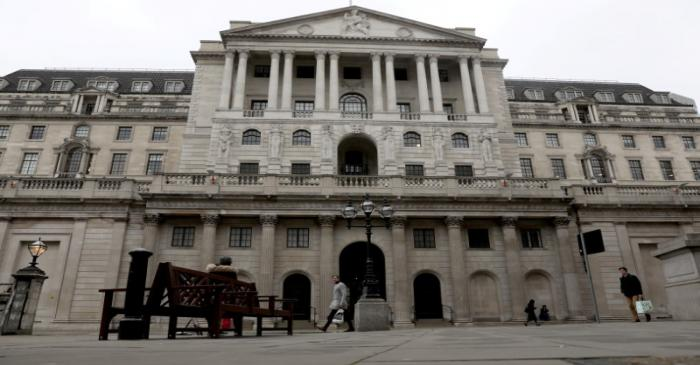 FILE PHOTO: People walk in front of the Bank of England, as the number of coronavirus disease