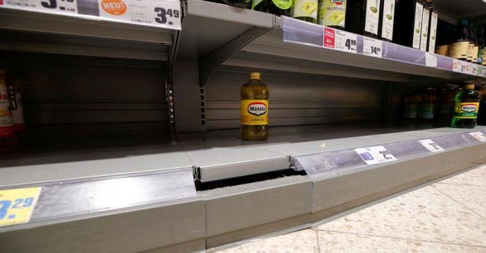 FILE PHOTO: Empty supermarket shelfs due to coronavirus (COVID-19) related panic buys over the