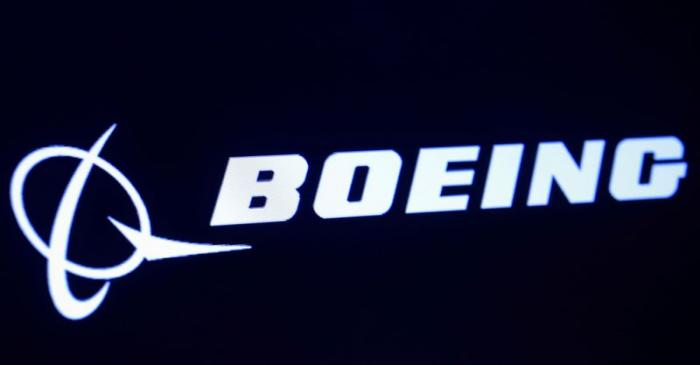 FILE PHOTO: The company logo for Boeing is displayed on a screen on the floor of the NYSE in