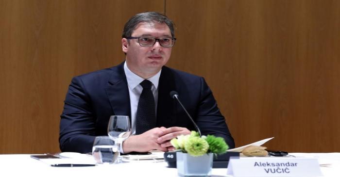 Serbia's President Aleksandar Vucic waits before a meeting of the EU-Western Balkans Summit at