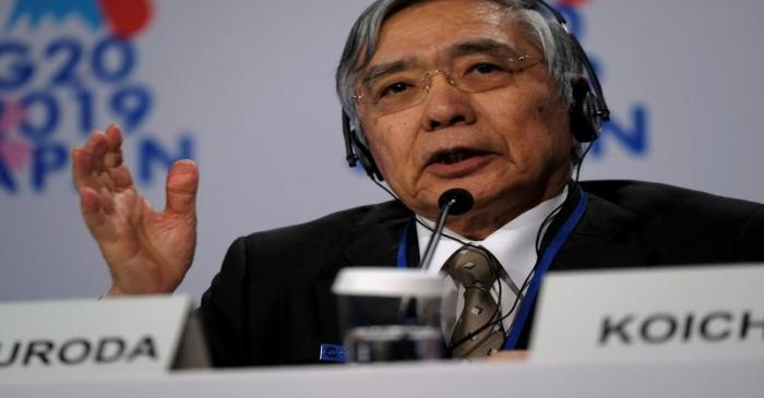 Bank of Japan Governor Haruhiko Kuroda takes questions from reporters at the annual meetings of