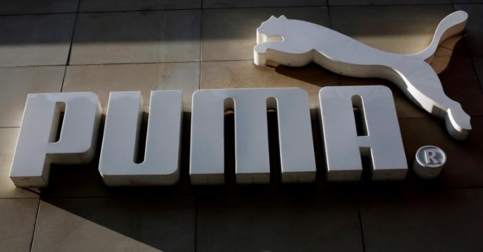 FILE PHOTO: The logo of German sports goods firm Puma is seen at the entrance of one of its