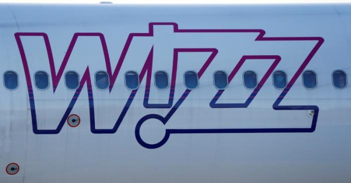 FILE PHOTO: Wizz Air Airbus 321-231 HA-LXJ aircraft taxis to runway at the Chopin International