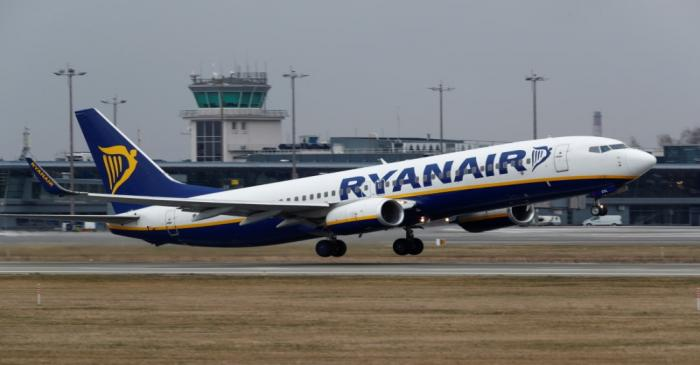 FILE PHOTO: Ryanair Boeing 737-8AS plane takes off before all international flights will be
