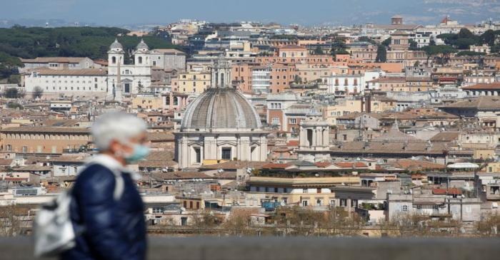 A woman walks at Gianicolo hill, as Italy tightens measures to try and contain the spread of