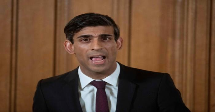 FILE PHOTO: British PM Johnson holds a news conference with Chancellor of the Exchequer Rishi
