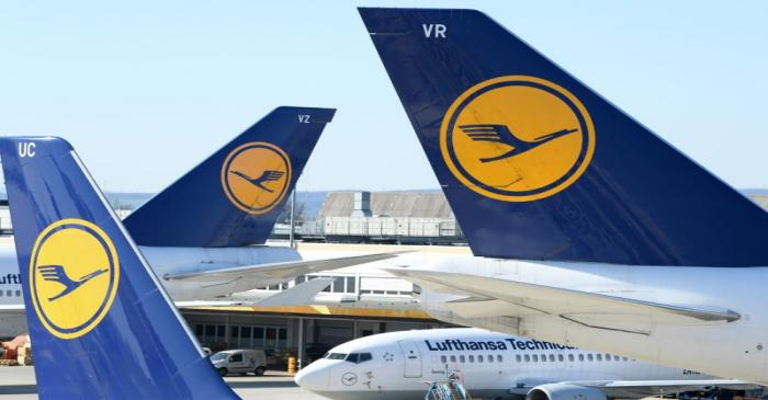 FILE PHOTO: Airplanes of German carrier Lufthansa are parked on the tarmac as air traffic is