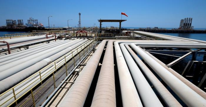 FILE PHOTO: An oil tanker is being loaded at Saudi Aramco's Ras Tanura oil refinery and oil
