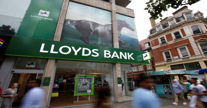 FILE PHOTO:  People walk past a branch of Lloyds Bank on Oxford Street in London