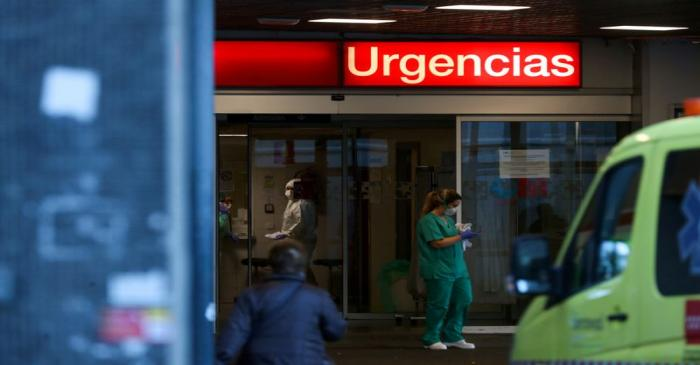 FILE PHOTO: Healthcare workers are pictured at the entrance of the emergency unit at La Paz