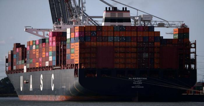 FILE PHOTO: Shipping containers stacked on a cargo ship are seen in the dock at the ABP port in