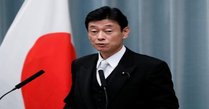 Japan's Economy Minister Nishimura attends a news conference at PM Abe's official residence in