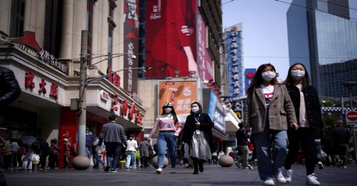 People wear masks at a main shopping area after the city's emergency alert level for