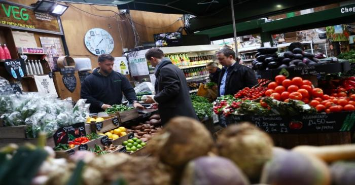 Customers at a food stall at Borough Market in London