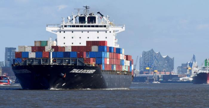 FILE PHOTO: A container ship leaves the port in front of famous landmark Philharmonic Hall in