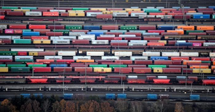 Containers are loaded on freight trains at the railroad shunting yard in Maschen near Hamburg