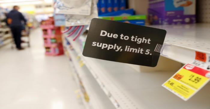FILE PHOTO: A sign is seen posted on shelves, after further cases of coronavirus were confirmed