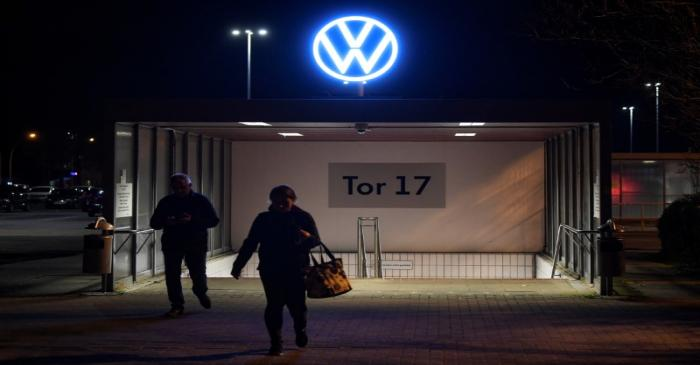 FILE PHOTO:  Employees leave the Volkswagen plant after VW starts shutting down production in