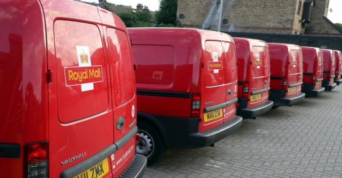 FILE PHOTO: Royal Mail vans are parked in the Leytonstone post office depot in London, Britain