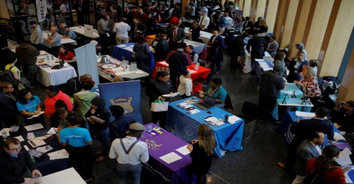 Job seekers speak with potential employers at a City of Boston Neighborhood Career Fair on May