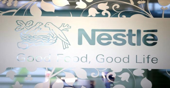 FILE PHOTO: Nestle logo is pictured on the door of the supermarket of Nestle headquarters in