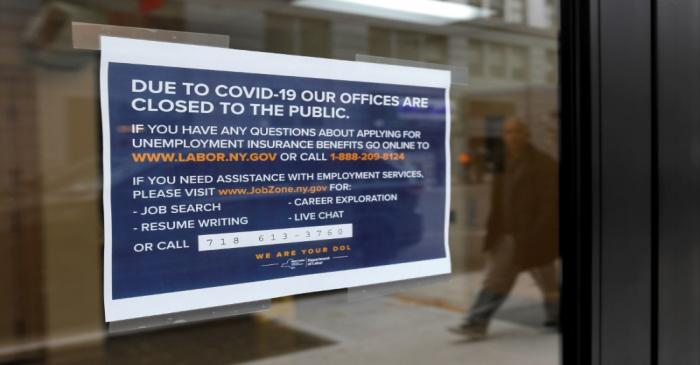 FILE PHOTO: Signage is seen posted on the entrance of the New York State Department of Labor