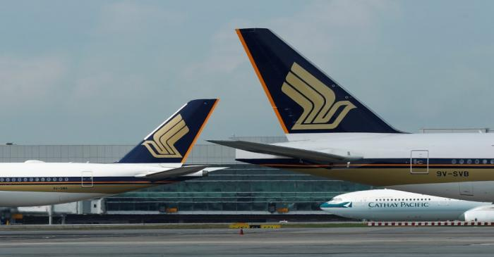 Singapore Airlines planes are pictured on the tarmac at Changi Airport