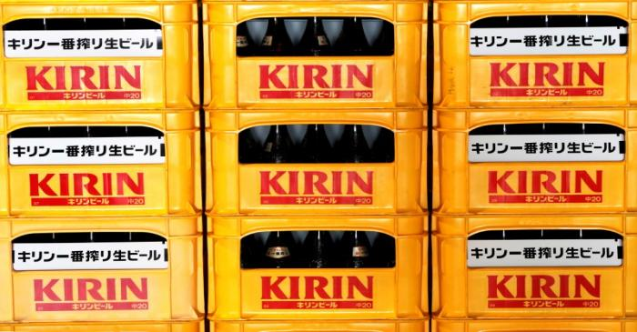 FILE PHOTO: Plastic cartons containing Kirin brand beer bottles are seen at Kirin Brewery Co.