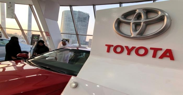 Customers look at 2019 Camry Hybrid in Toyota dealer in Dhahran, Saudi Arabia