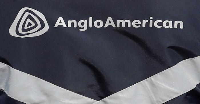 Logo of Anglo American is seen on a jacket of an employee at the Los Bronces copper mine, in