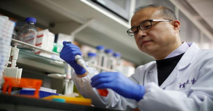 FILE PHOTO: Scientist Linqi Zhang in his laboratory at Tsinghua University's Research Center