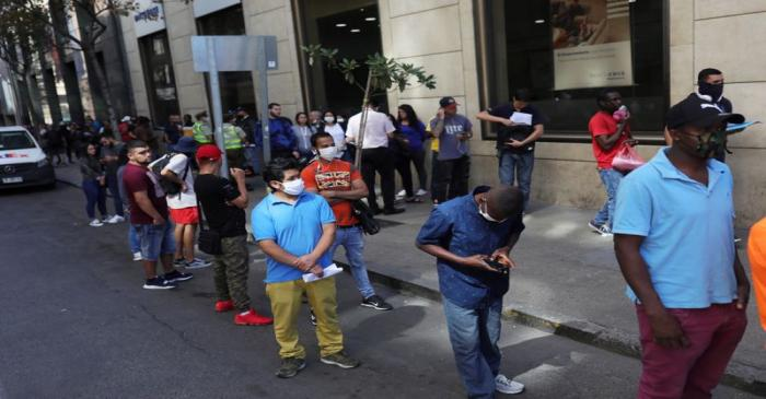 Suspensions and layoffs cause long lines of workers applying for unemployment insurance during