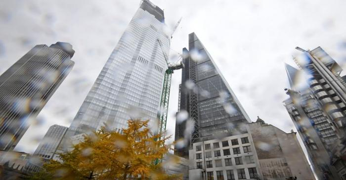 FILE PHOTO:  A tree covered in autumn foliage is seen with office skyscrapers around it during