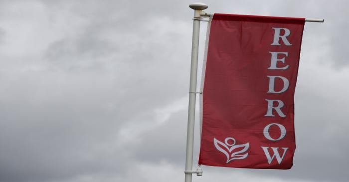 FILE PHOTO: The company logo of construction company Redrow is pictured on a flag at a new