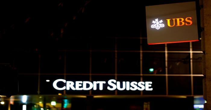 FILE PHOTO: Logos of Swiss banks UBS and Credit Suisse are seen in Basel