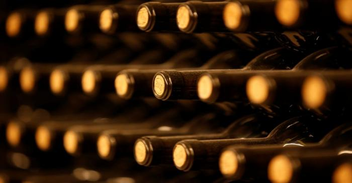 Bottles of red wine are seen in the cellar of Chateau Le Puy in Saint Cibard