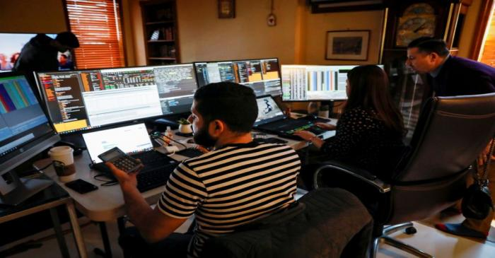NYSE-AMEX Options floor traders from TradeMas Inc. work in an off-site trading office  due to