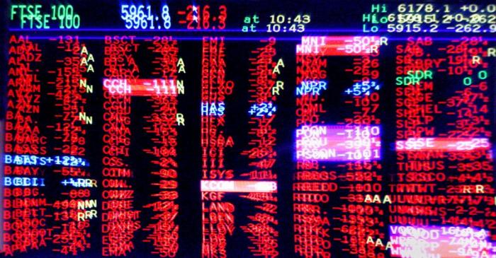 FILE PHOTO: London trading screen shows market slump