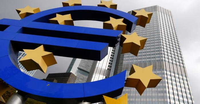 A euro logo sculpture stands in front the headquarters of the European Central Bank  in