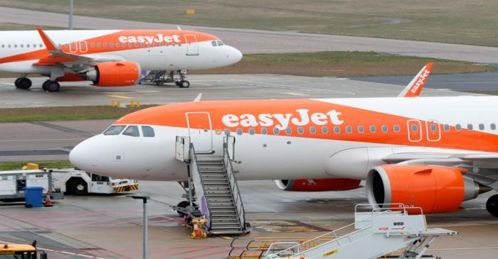 FILE PHOTO: EasyJet planes parked at Luton airport after the airline grounded its entire fleet