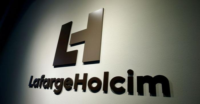 FILE PHOTO: The logo of LafargeHolcim, the world's largest cement maker, is seen in Zurich