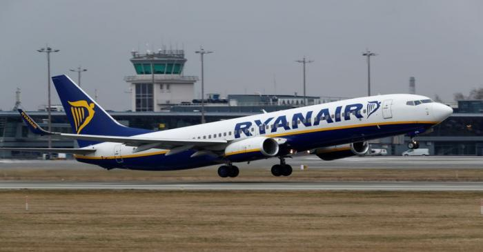 FILE PHOTO: A Ryanair Boeing 737-8AS takes off before all international flights were cancelled